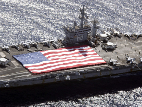 stocktrek-images-personnel-participate-in-a-flag-unfurling-rehearsal-on-the-flight-deck-aboard-uss-nimitz